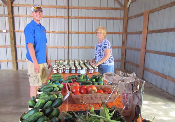 Workers help prepare produce at Neltner Farm in Camp Springs