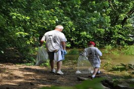 Northern Kentuckians participate in a Licking River cleanup day.