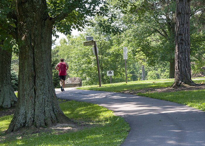 Runners frequent Devou Park's paved trails.