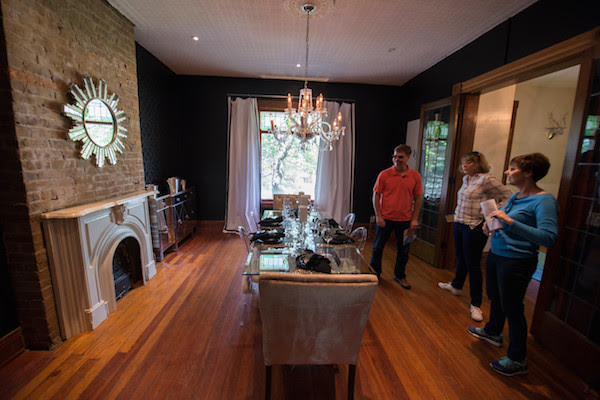 Visitors explore a newly renovated historic home in Bellevue