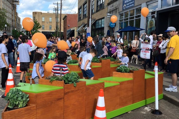 One of five Curb'd street installations offers hopscotch and seating in front of Braxton Brewing