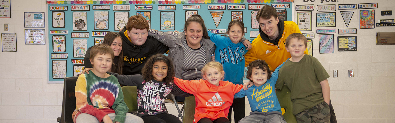 A group of Bellevue students, ranging from elementary school kids through current seniors. <span class='image-credits'>Joe Simon</span>