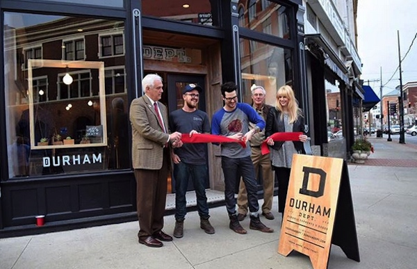 Austin Dunbar (center) opens the Dunham Dept. retail store at Madison & Pike Sts. in Covington