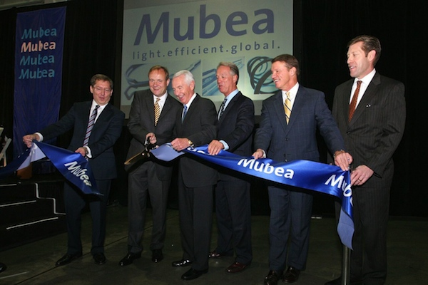Mubea North America expanded its Northern Kentucky operations in 2013 with (L-R) CEO Doug Cain, General Partner Thomas Muhr, Gov. Steve Beshear, Gary Moore, Steve Pendery and Steve Stevens