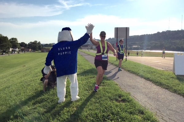 Catherine Hamilton Hicks' husband dressed in an old Slush Puppie mascot costume to greet runners in Dayton last month