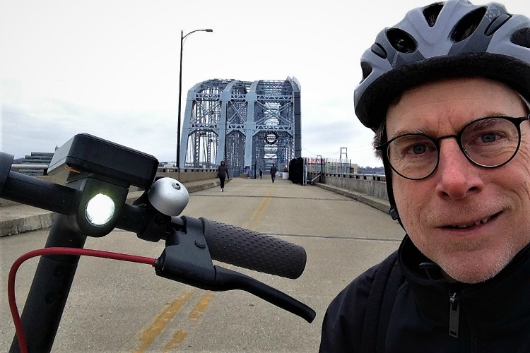 Author David Holthaus says that the Bird scooter was a quick, fun way to travel across the Purple People Bridge.