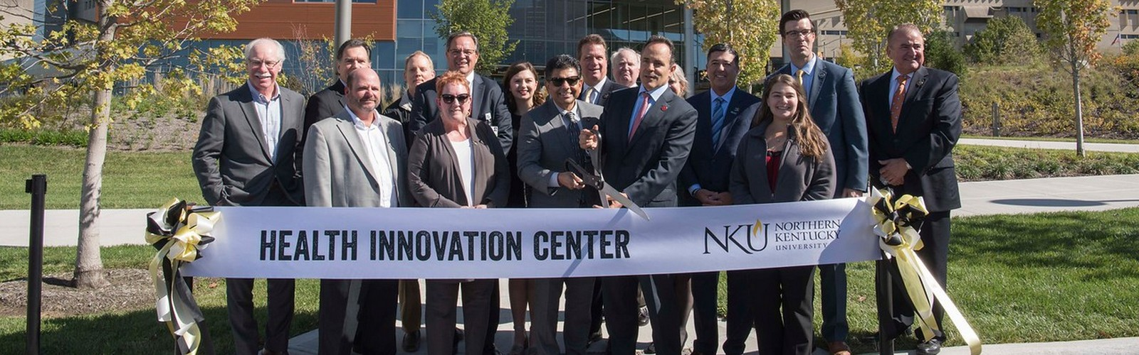 NKU President Ashish Vaidya and Kentucky Gov. Matt Bevin lead the ribbon-cutting for NKU's Health Innovation Center. <span class='image-credits'></span>