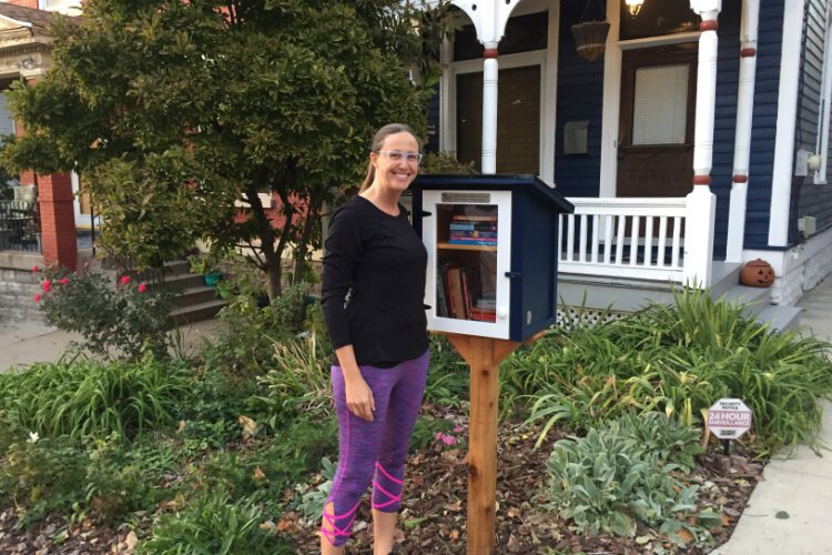 "Kate Westrich and her ""Little Blue House Library"" in Clifton, charter #75890."