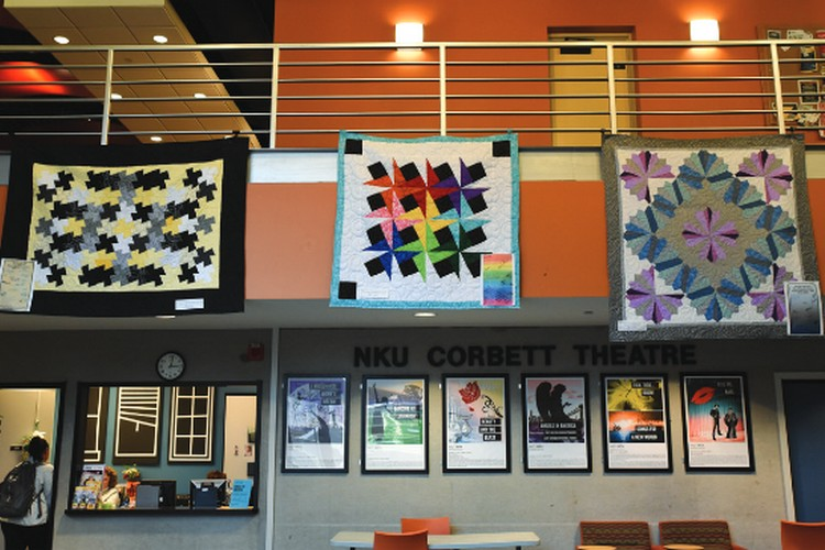 "Two theater classes in 2018 combined with the cast of NKU's production of ""Angels in America"" to create these three quilts, which then raised $2,040 at auction to benefit Caracole."