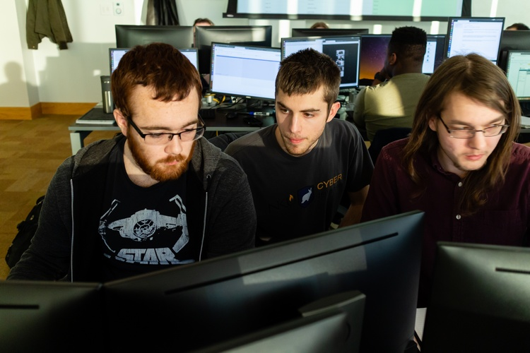 In the JRG Cyber Threat Intelligence Lab are Zeb Gentry, Bradley Hatting and Justin Flynn.