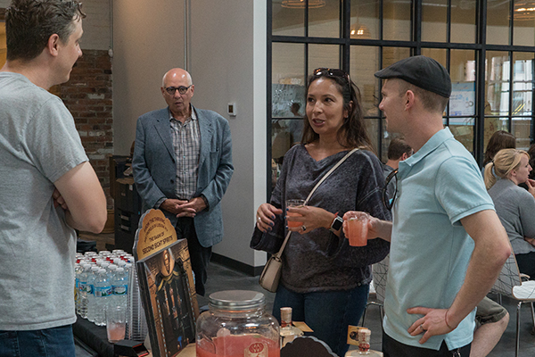 Guests mingle over cocktails provided by Second Sight Spirits in Latonia.