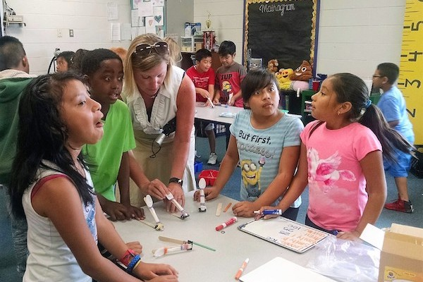 Stacie Strotman with students on Summer Learning Day.