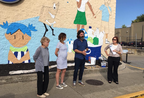 Left to right: Covington Mayor Sherry Carran, joins Lesley Amman and Jarrod Becker of BLDG, and Patty Leeseman of Kroger, at Thursday's introduction of the mural.