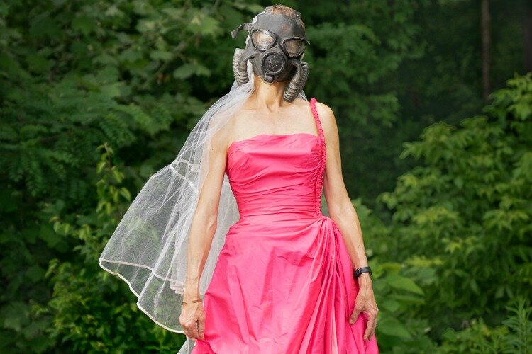 Pamela Jean Shaffer in formal gas mask attire (photo has been cropped)